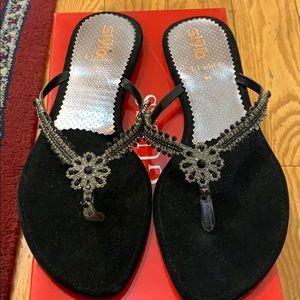 Black jeweled flip flops